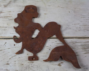 Rusty metal sitting mermaid