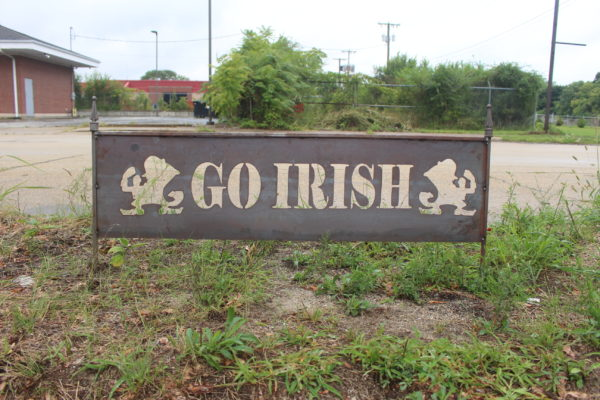 Rusty yard sign