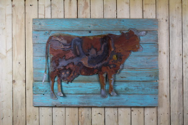 cow on painted woodback