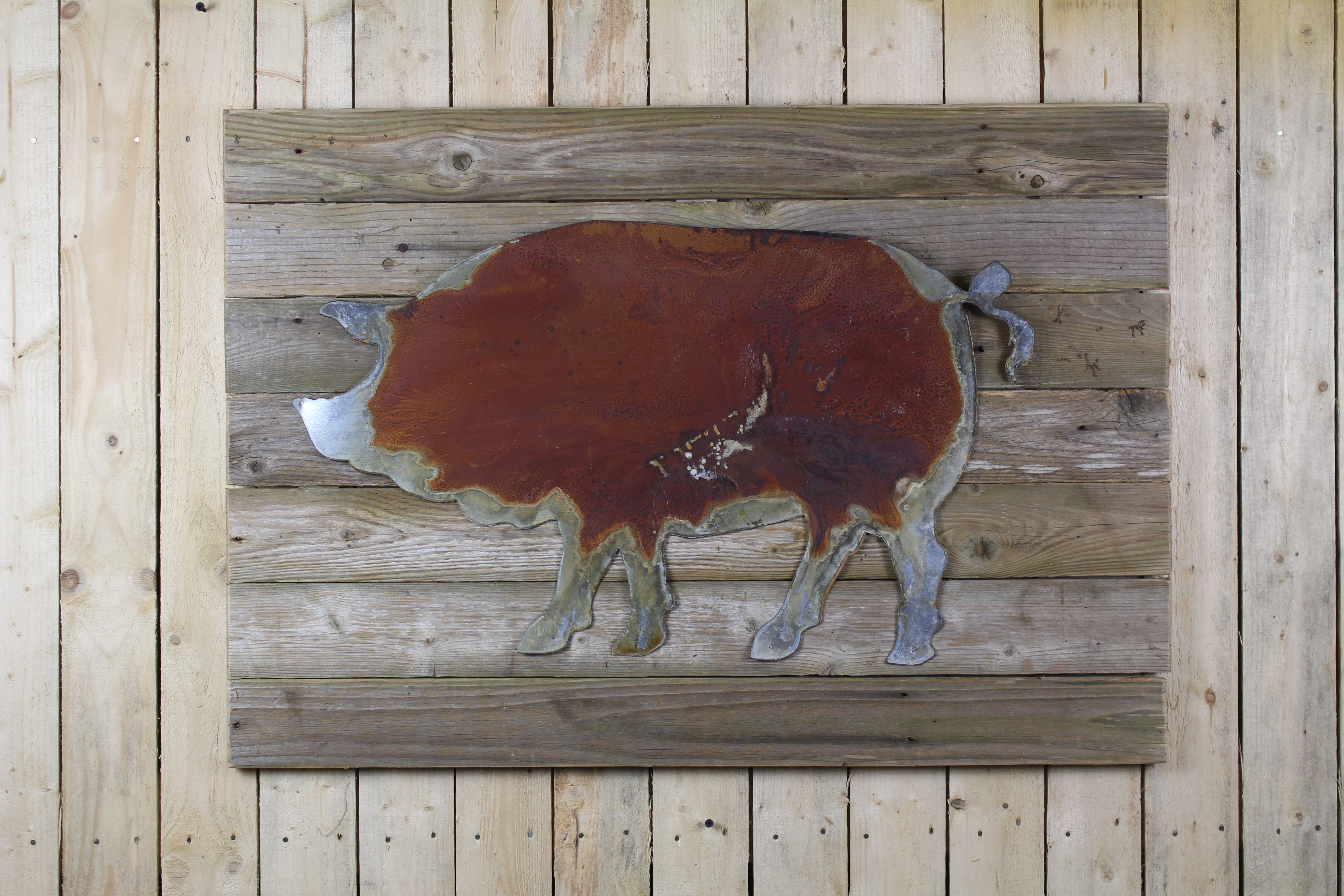Rustic pig on woodback