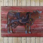 Rustic cow on painted woodback