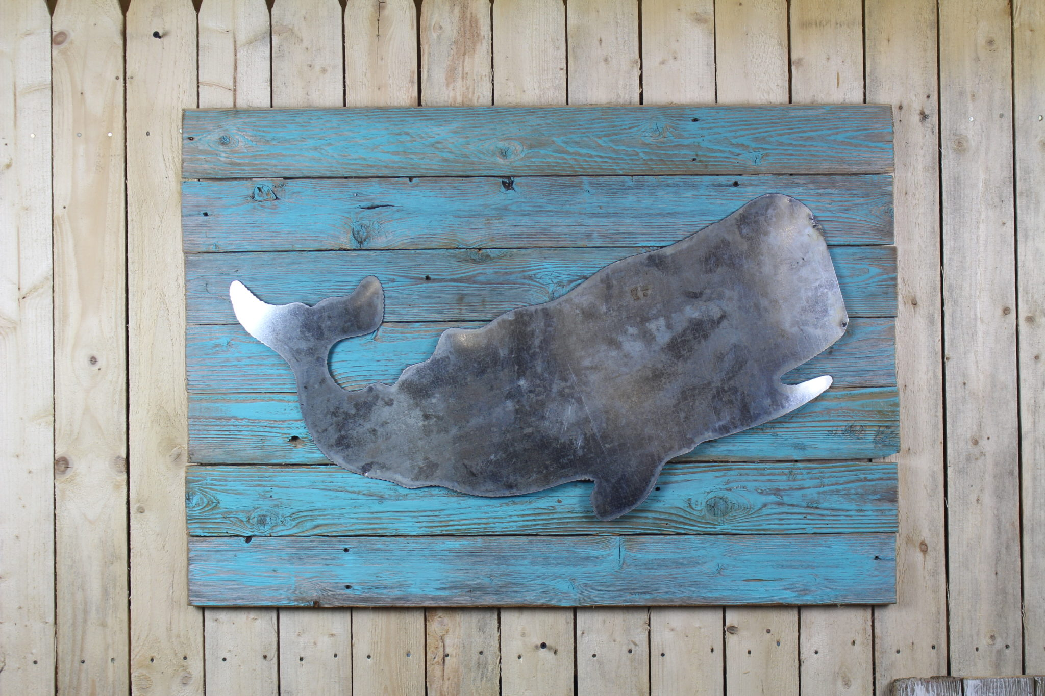 Rustic whale on painted woodback