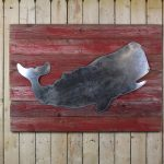 Rustic whale on woodback